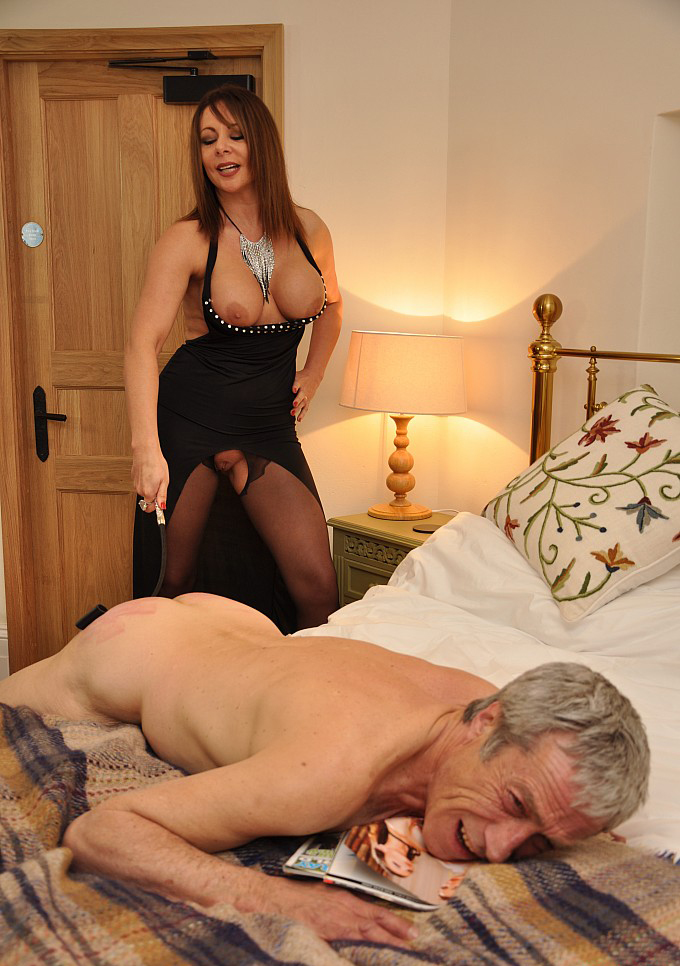 Mistress preparing slaves body for action in the bed 4
